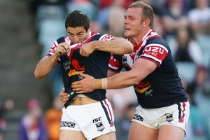 Anthony Minichiello (L) of the Roosters celebrates with Martin Kennedy (R) after scoring a try. Photo / Getty Images
