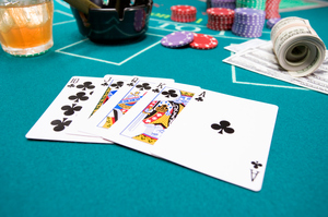 The chance of being dealt a royal flush is 650,000 to one. Photo / Thiinkstock