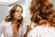 Women look in the mirror on average eight times a day. Photo / Thinkstock