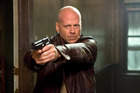 Bruce Willis has mocked Robert Pattinson and Kristen Stewart's relationship woes in a Die Hard spoof. Photo / Supplied