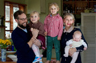 Ingrid Starnes and Simon Pound with four-year-old twins Ned and Olya and baby Gertie, five months. Photo / Sarah Ivey
