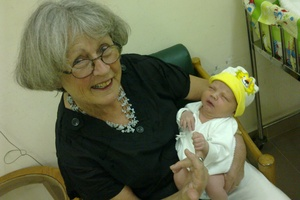 Julie Ferne holding her grandson Carter. Photo / supplied