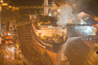More than a dozen fire trucks were battling a major blaze on board a ship in Lyttelton overnight. Photo / Aaron Campbell