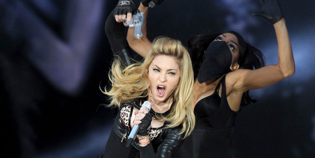 Madonna says her use of fake guns during concerts is just a metaphor. Photo / AP