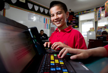 The trust provides cheap computers and internet for children such as Calvin Smith in low-decile schools in Tamaki/Glen Innes. Photo / Sarah Ivey