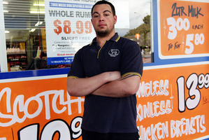 Apprentice butcher TJ Morecraft outside Wholesale Meats Onehunga. Customers tend to buy sausages rather than steak when Lotto jackpots. Photo / Doug Sherring