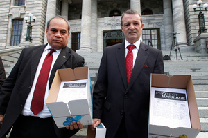 Labour MPs Su'a William Sio, left, and Ross Robertson with the petition opposing gay marriage. Photo / Mark Mitchell