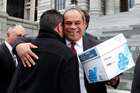 Labour MP Su'a William Sio gets a hug from Family First NZ member Steve McRobie after receiving the petition. Photo / Mark Mitchell