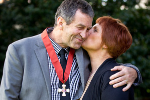 Wayne Smith with his wife Trish after receiving the insignia of a companion of the New Zealand Order of Merit for services to rugby during the ceremony at Government House today. Photo / Dean Purcell