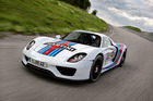The 918 Spyder sports the historic Martini Racing colours.