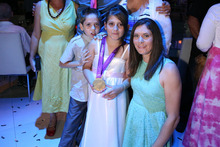 Jo Aleh with siblings Yaam, left, and Shefa Shukrun, in Israel. Photo / Supplied