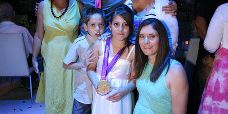  Jo Aleh with siblings Yaam, left, and Shefa Shukrun, in Israel. Photo / Supplied