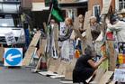 Supporters of WikiLeaks founder Julian Assange outside the Ecuadorian Embassy in London. Photo / AP