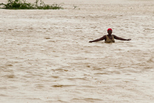 A woman wades through flood waters in Port-au-Prince, Haiti. Photo / AP