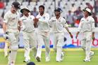 India's bowler Pragyan Ojha, centre, celebrates the dismissal of NZ's batsman Kane Williamson. Photo / AP