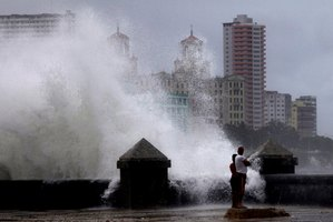 Waves pound the boardwalk, the Malecon, during the passing of Tropical Storm Isaac in Havana Cuba. The storm is now due to hit the coast of Louisiana and Florida. Photo / AP