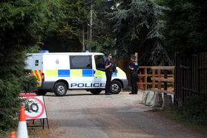 Police stand at Earls Hall Farm in St Osyth, southern England where a lion was apparently seen yesterday. Photo / AP