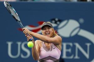 Maria Sharapova, of Russia, returns a shot to Melinda Czink, of Hungary, at the 2012 US Open Tennis tournament. Photo / AP