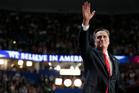 Republican presidential nominee Mitt Romney waves to delegates after his speech, which was aimed at letting Americans know him better.  Photo / AP