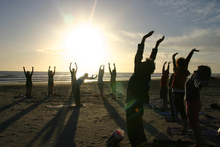 A Waihi beach class salutes the sun on New Year's Day. Photo / Bay of Plenty Times