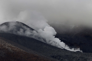 Steam billows from vents at the summit of Mt Tongariro. Photo / Alan Gibson