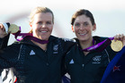 Olivia Powrie (left) and Jo Aleh picked up gold in the 470 dinghy sailing class. Photo / Mark Mitchell