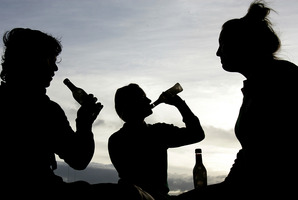 John Key says a licensed bar environment is well supervised, but off-licences are a source of alcohol for younger people indulging in binge-drinking. Photo / APN