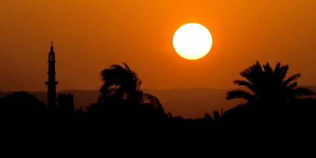The sun sets over the Nile. Photo / Alan Gibson