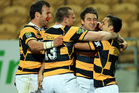 L to R, Frazier Climo, Willie Rickards, Kurt Baker and Jamison Gibson-Park of Taranaki celebrate Kurt Baker's try. Photo / Getty Images.