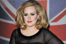 Adele says she is definitely not married, and is tired of the rumours. Photo / Getty