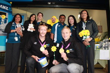 Hamish Bond and Eric Murray with ANZ staff collecting for Daffodil Day on Queen Street this morning. Photo / Paul Harper