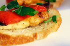 Grilled haloumi and roasted peppers on crostini. Photo / Michael Craig
