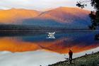 Dawn is breathtaking at lake Te Anau. Photo / Josie Dale