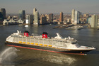 The Disney Fantasy cruise liner sails past the Manhattan skyline en route to its new home port at Port Canaveral in Florida. Photo / Creative Commons image by Flickr user insidethemagic