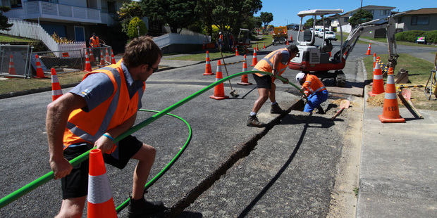 There are early signs that demand for high speed fibre is emerging, says Chorus chief executive Mark Ratcliffe. Photo - workers laying new fibre cables. Supplied