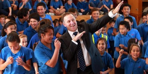 """Prime Minister John Key seems to have invented a new dance move called the """"Usain Bolt""""."""