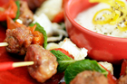 Tasty lamb skewers with mozzarella. Photo / Michael Craig