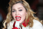 Madonna has apologised for not bringing her MDNA tour Down Under. Photo / AP