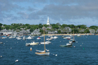 Boats bob in Nantucket Harbour, with its backdrop of genteel houses clad in grey slatted cedar tiles. Photo / Thinkstock
