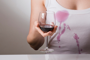 "After spilling most of the glass' contents, ever ended up thinking, ""May as well just have a shirt made of wine.'? Science has proven this isn't as ludicrous as you think. Photo / Thinkstock"