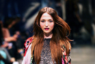 A model wears an outfit by Coop on day one of New Zealand Fashion Week. Photo / Babiche Martens