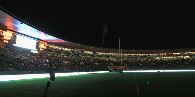Westpac Stadium is enveloped in darkness during the halftime power failure. Photo / Getty Images