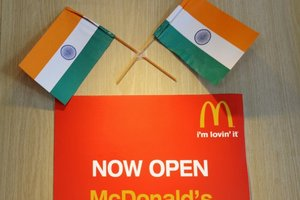 Two Indian flags adorn a sign at a local McDonalds chain restaurant on Independence Day in New Delhi. Photo / AFP