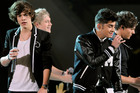 One Direction will be able to keep their name after settling a legal battle. Photo / AP