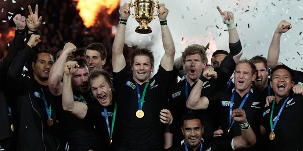 All Blacks captain Richie McCaw holds aloft the Webb Ellis Cup, after the team won the Rugby World Cup final match between New Zealand and France. Photo / Brett Phibbs