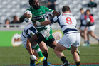Tomasi Cama of Manawatu fends off Alby Mathewson of Auckland during the round three ITM Cup match between Auckland and Manawatu at Eden Park. Photo / Getty Images.