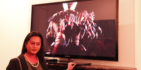 Auckland artist Shigeyuki Kihara stands in front of her video tribute, titled Galu Afi: Wave of Fire. Picture / Tanya Ruka