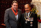 All Blacks coach Steve Hansen with Governor-General Lt General Sir Jerry Mateparae, during his investiture at Government House in Wellington today. Photo / Mark Mitchell