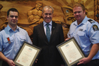 Dean Kaire (left) and Phil Boughey with minister David Carter (centre). Photo / Supplied