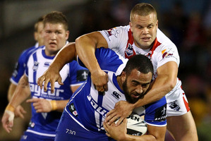 Sam Kasiano of the Bulldogs is tackled by Mitch Rein and Dan Hunt of the Dragons. Photo / Mark Nolan